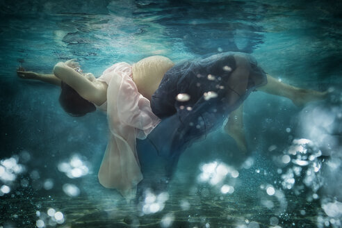 Pregnant woman wearing dress under water - STBF00255