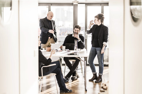 Business people work relaxed together in bright office - MJRF00086
