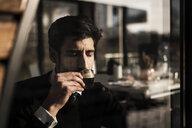 Businessman enjoying his coffee - MJRF00125