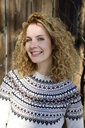 Blonde woman with curly hair smiling, norwegian sweater - ECPF00604