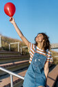 Young woman holding red ballon - AFVF02618