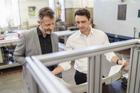 Two businessmen discussing plan in a factory - DIGF06224