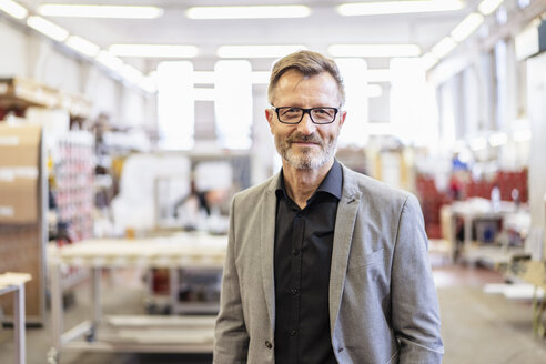 Portrait of confident businessman in factory - DIGF06263