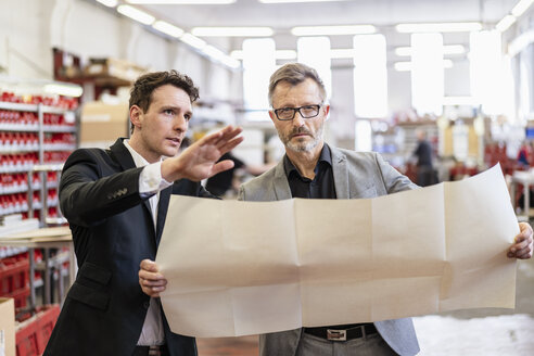 Two businessmen discussing plan in a factory - DIGF06266