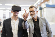 Two businessmen with VR glasses in factory - DIGF06269
