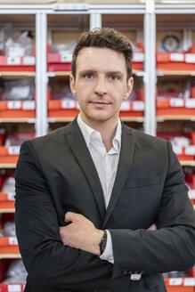 Portrait of confident businessman in factory - DIGF06278