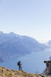 Woman hiking in the mountains. Como, Lecco. - MRAF00380