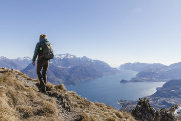 Italy, Como, woman on a hiking trip in the mountains above Lake Como - MRAF00386
