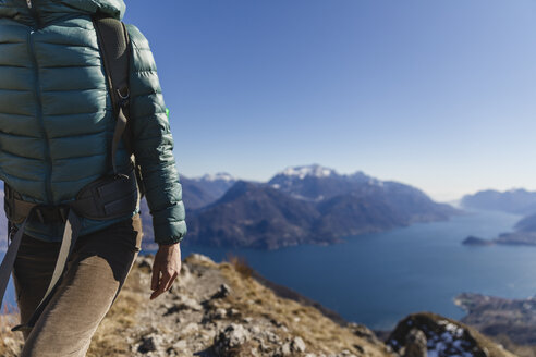 Italy, Como, Lecco, woman on a hiking trip in the mountains above Lake Como - MRAF00392