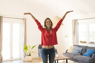 Portrait of carefree woman at home - SBOF01926