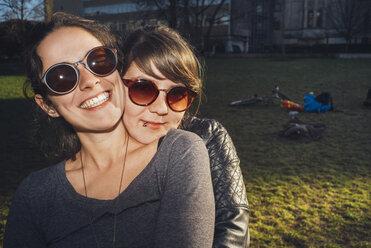 Portrait of two happy women in park - GCF00249
