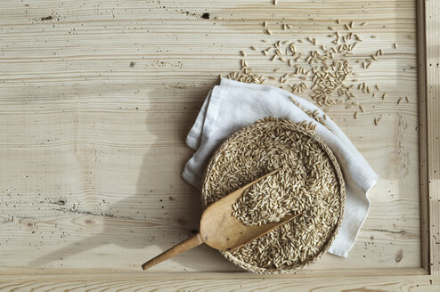 Organic oat, whole grains in bast bowl on wood, from above - ASF06326