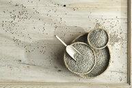 Organic rye, rye shot in bast bowl, shovel on wood - ASF06329