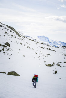 Rear view of man with backpack, snowcapped mountains - ACPF00497