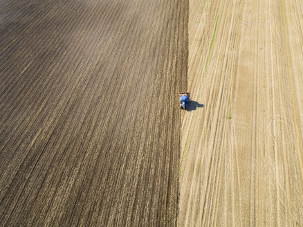 Aerial View Of Tractor Ploughing In Farm Field - JUIF00203