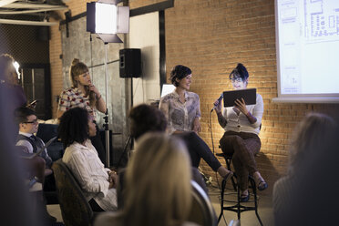 Female designers with microphone and digital tablet leading conference meeting - HEROF30711