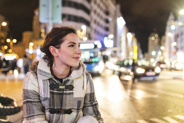 Spain, Madrid, young woman in the city at night next to Gran Via - WPEF01393