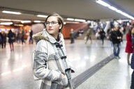 Spain, Madrid, young woman in a busy metro station - WPEF01408