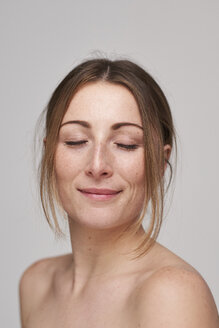 Portrait of beautiful young woman with freckles and closed eyes - PNEF01363