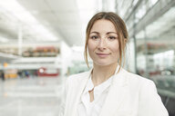 Portrait of smiling young businesswoman at the airport - PNEF01369