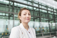 Portrait of confident young businesswoman in front of a building - PNEF01381