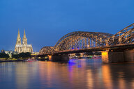 Germany, Cologne, view to Cologne Cathedral with Hohenzollern Bridge and River Rhine in the foreground - MKFF00473