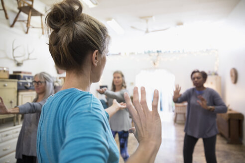 Fitness instructor leading tai chi exercise class - HEROF31410