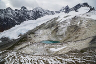 Glacial lake below snowy glacier and mountains, North West British Columbia, Canada - HEROF31476