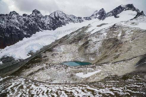 Glacial lake below snowy glacier and mountains, North West British Columbia, Canada - HEROF31476