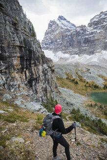 Hiker looking at scenic mountain view, Lake O - HEROF31479