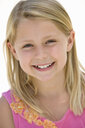 Portrait of girl (5-7) smiling, close-up - JUIF00365