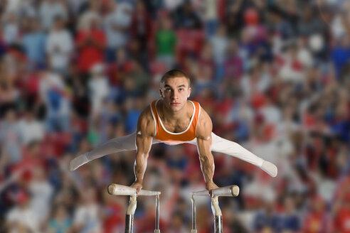 Male gymnast performing on parallel bars - JUIF00401
