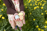 Young girl holding decorated Easter eggs - JUIF00404