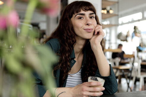 Portrait of confident young woman in a cafe - FLLF00074