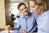 Man and woman with tablet in a cafe - PNEF01389