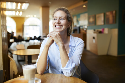 Portrait of happy woman in a cafe - PNEF01401