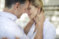 Close-up of affectionate couple hugging outdoors - PNEF01446