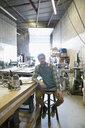 Portrait confident male carpenter in workshop - HEROF31523