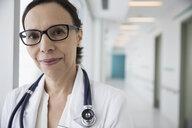 Portrait confident female doctor in clinic corridor - HEROF31631