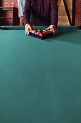 Close-up of billiards player arranging balls on table - ZEDF02033