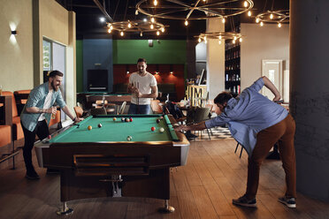 Friends playing billiards together - ZEDF02045