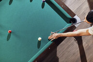 Top view of man playing billiards - ZEDF02060