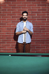 Portrait of smiling man at billiard table - ZEDF02075