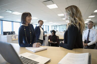 Businesswomen talking in office meeting - HEROF31929