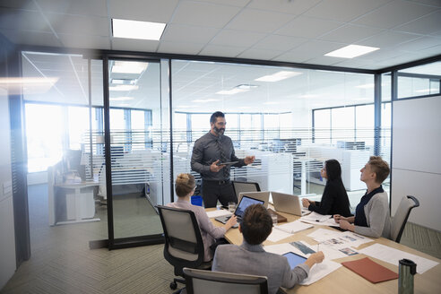 Businessman leading conference room meeting - HEROF31992