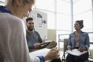 Smiling creative designers brainstorming in office meeting - HEROF32130