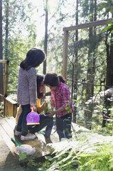 Sisters on balcony in woods - HEROF32182