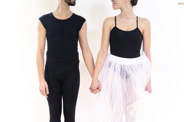 Dancing couple holding hands in studio - FMOF00474