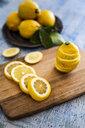 Sliced lemons on wooden board - GIOF05890