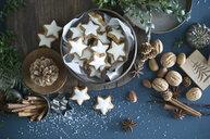 Cinnamon stars in tin can, star anise, cinnamon sticks, nutcracker and pine cones - ASF06354